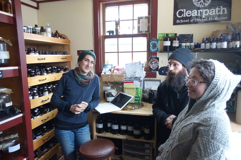 Gina, Chris S., and Lilly in apothecary March